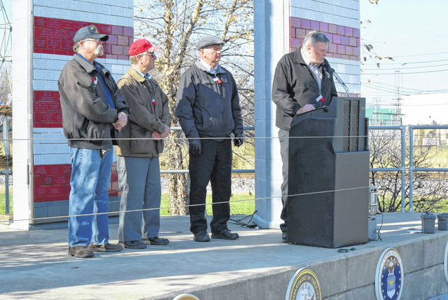Veterans were remembered during a ceremony at the Veterans Freedom Flag Monument, Sunday. Participating, from left to right Joe Brown, David Beck, Kevin Haver and Greg Gebolys.