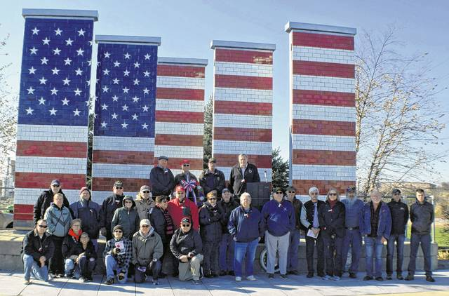 Veterans and their families marked Veterans Day at the Veterans Freedom Flag Monument, Sunday.