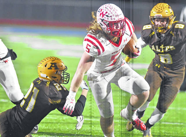 Wapakoneta's Evan Kaeck looks to maneuver past Kettering Alter's Liam Simms during Friday night's Division III, Region 12 final at Alexander Stadium in Piqua.