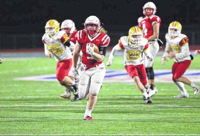 Wapakoneta's Evan Kaeck heads to the end zone during Friday night's Division III, Region 12 semifinal against Bishop Fenwick at Alexander Stadium in Piqua.