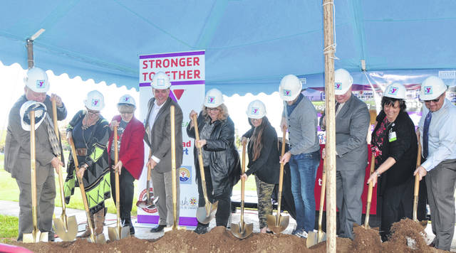 The Wapakoneta Family YMCA Board of Directors and its partners break ground for its new $7.5 million expansion during a ceremony Monday at the Wapakoneta Family YMCA.