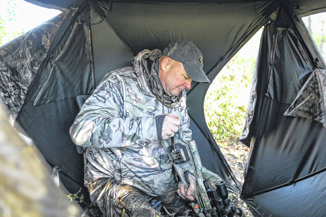 United States Army Veteran David Jacobsen of Cincinatti cranks his crossbow during the 10th annual Ted Epple Veterans with Disabilities Bow Hunt on Saturday morning.