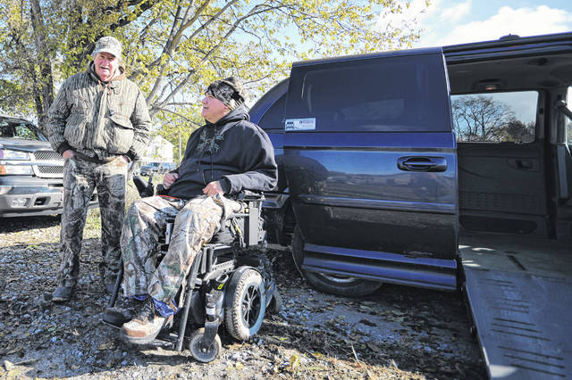 Carl Worsham of Lima and Tony Schmitmeyer of Fort Loramie talk during the 10th annual Ted Epple Veterans with Disabilities Bow Hunt on Saturday morning.