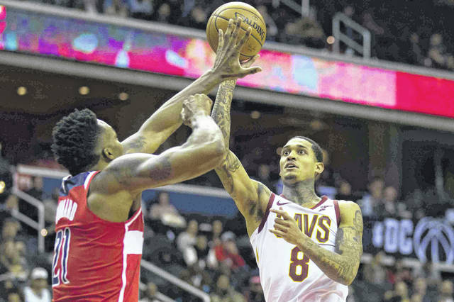 Cleveland Cavaliers guard Jordan Clarkson (8) shoots over Washington Wizards center Dwight Howard (21) during the first half of an NBA basketball game Wednesday, Nov. 14, 2018, in Washington. (AP Photo/Alex Brandon)