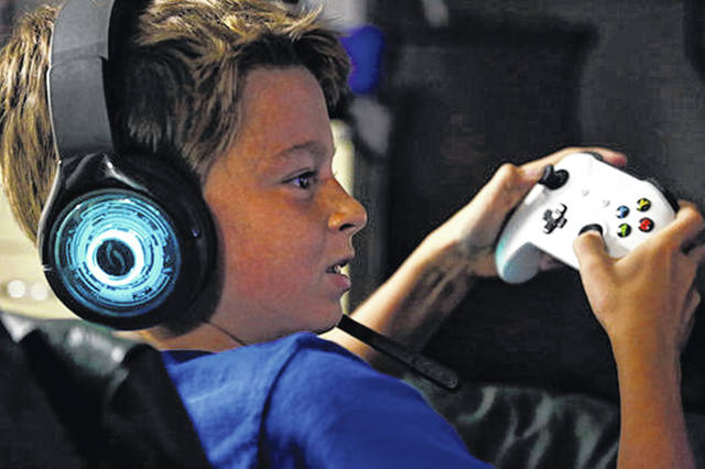 Henry Hailey, 10, plays the online game Fortnite in the early morning hours of a Saturday in September in the basement of his Chicago home. His parents are on a quest to limit screen time for him and his brother. The boys say they understand sometimes, but also complain that they get less screen time than their friends.