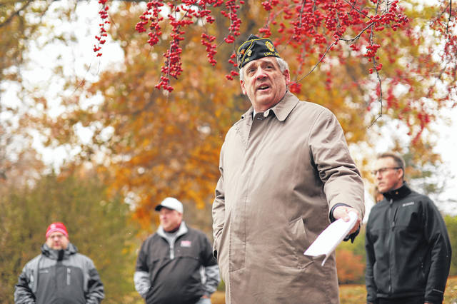 Marine Veteran Larry Huffman speaks before the flag raising ceremony at Faurot Park on Saturday morning to commemorate the 100th anniversary of the end of World War I.