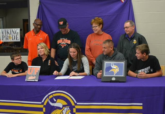 Leipsic's Carlee Siefker is joined by family and others during her signing ceremony.