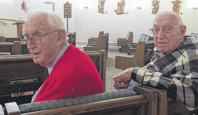 Earl and Don Krumel are two World War II veterans who have been voting for 72 years. Don, pictured at right, has never missed a vote while Earl has missed just one. Photo by Jim Krumel | The Lima News