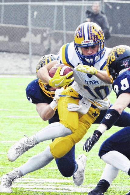 Marion Local's Matt Rethman fights for yardage during Friday's Division VI state championship game against Kirtland at Tom Benson Stadium in Canton.