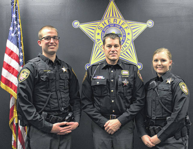 Allen County Sheriff Matt Treglia is flanked by his newest deputies, Travis Christy and Andrea Geise.