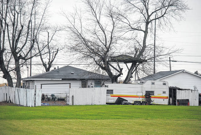 A travel trailer at the rear of a property at 102 W. Hanthorn Road must be moved or otherwise made operable within 45 days and junk scattered around the property must be cleaned up as part of a court-sanctioned agreement between the Perry Township Trustees and resident Floyd Russell.