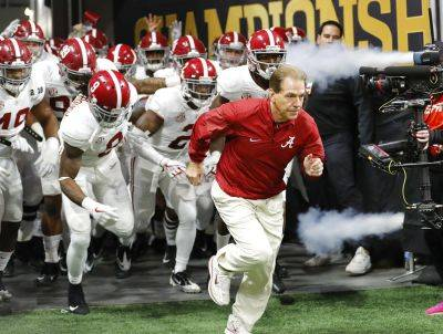Head coach Nick Saban and the Alabama Crimson Tide remain atop the College Football Playoff rankings.