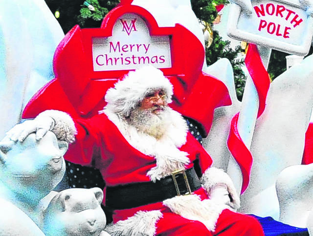 Santa Claus sits at the Miami Valley Centre Mall North Pole waiting on area children of all ages to visit him. The mall will be open beginning at 6 a.m. on Friday and 8 a.m. on Saturday. Store hours for various retailers may vary.