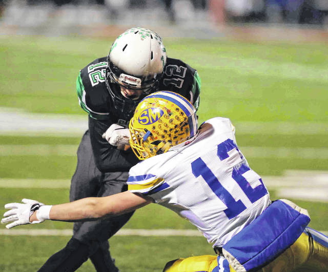 St. Marys' Howell stops Clear Fork's A.J. Blubaugh during Saturday night's Division IV, Region 14 final in Bellefontaine.