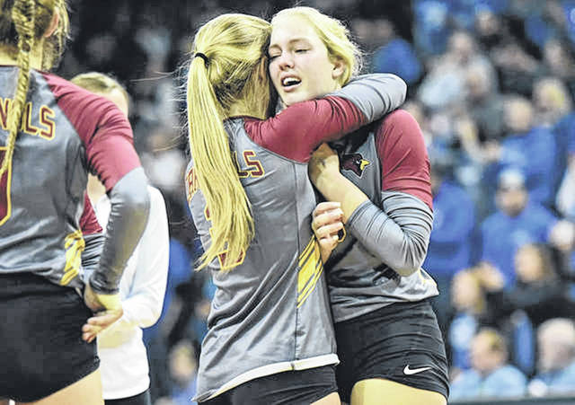 New Bremen's Diana Heitkamp, left, hugs Ashton Heitkamp after the Cardinals fell to Tiffin Calvert in Saturday's Division IV state final at Wright State's Nutter Center in Fairborn.