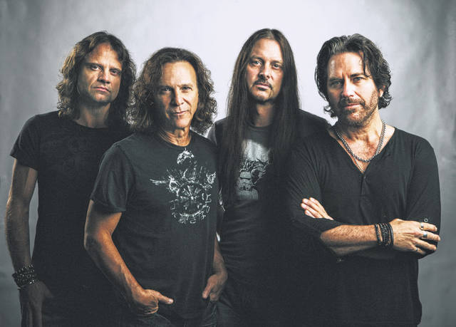 Winger is comprised of (from left to right) rhythm guitarist John Roth, drummer Rod Morgenstein, lead guitarist Reb Beach and front-man Kip Winger.