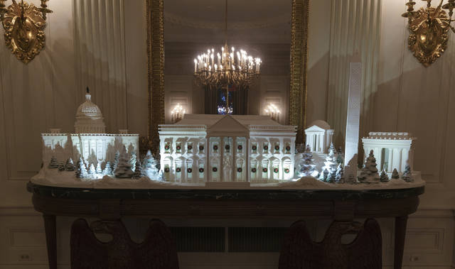 "FILE - In this Nov. 26, 2018 file photo, the gingerbread house, showcasing the full expanse of the National Mall: the Capitol, the Lincoln Memorial, the Jefferson Memorial, the Washington Monument, and, the White House is seen in the State Dining Room during the 2018 Christmas Press Preview at the White House in Washington. The theme of this year's White House holiday decor, revealed by the first lady this week, is ""American Treasures,"" The Associated Press reported. It is not ""Christmas Traditions,"" as claimed in a social media post. One element that is significantly different this year is the traditional White House gingerbread house, which is a massive, sugary replica of the entire National Mall.  (AP Photo/Carolyn Kaster, File)"