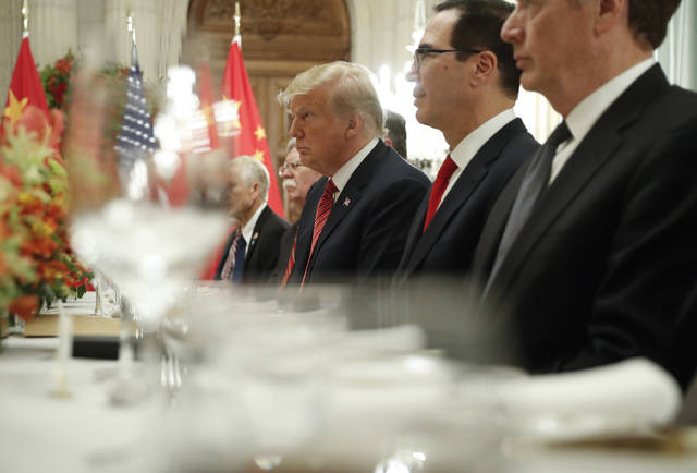 President Donald Trump, center, and Treasury Secretary Steve Mnuchin, second from the right, listen to remarks by China's President Xi Jinping during a bilateral meeting at the G20 Summit, Saturday, Dec. 1, 2018 in Buenos Aires, Argentina. (AP Photo/Pablo Martinez Monsivais)