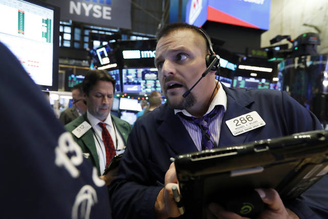 Trader Michael Milano, right, works on the floor of the New York Stock Exchange, Monday, Dec. 3, 2018. Stocks are opening sharply higher on Wall Street, following gains in overseas markets after the U.S. and China struck a 90-day truce in their trade dispute. (AP Photo/Richard Drew)