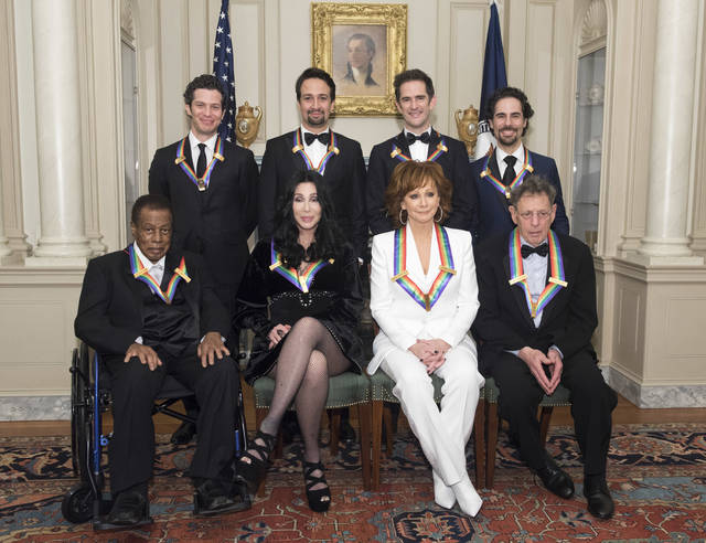 "2018 Kennedy Center Honorees, front row form left, Wayne Shorter, Cher, Reba McEntire, Philip Glass, back row from left, the co-creators of ""Hamilton,"" Thomas Kail, Lin-Manuel Miranda, Andy Blankenbuehler, Alex Lacamoire pose for the group photo at the State Department for the Kennedy Center Honors State Department Dinner on Saturday, Dec. 1, 2018, in Washington. (AP Photo/Kevin Wolf)"