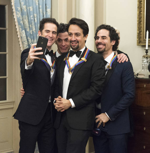 "2018 Kennedy Center Honorees the co-creators of ""Hamilton,"" from left, Andy Blankenbuehler, Thomas Kail, Lin-Manuel Miranda, and Alex Lacamoire pose for a selfie following the Kennedy Center Honors State Department Dinner on Saturday, Dec. 1, 2018, in Washington. (AP Photo/Kevin Wolf)"
