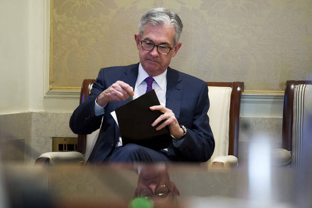 FILE- In this Thursday, Nov. 29, 2018, file photo Federal Reserve Chairman Jerome Powell waits to address the Federal Reserve Board's 15th annual College Fed Challenge Finals in Washington.  The Federal Reserve says that the U.S. economy was growing in the fall, but there were concerns about higher tariffs from a widening trade war, rising interest rates and tight labor markets. In its latest report on economic conditions around the country, the Fed says most of its 12 regions saw moderate growth through late November. Dallas and Philadelphia says growth had slowed while St. Louis and Kansas City depicted growth as slight. (AP Photo/Cliff Owen, File)