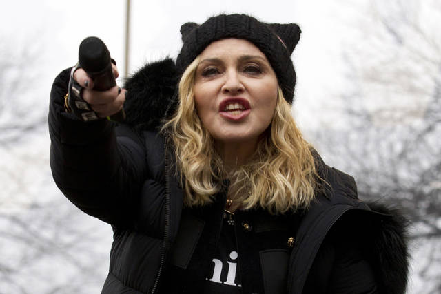 FILE - In this Saturday, Jan. 21, 2017 file photo, Madonna performs during the Women's March on Washington. On Friday, The Associated Press has found that stories circulating on the internet that she intends to vote for President Donald Trump in 2020 are untrue.