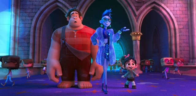 """FILE - This image released by Disney shows characters, from left, Ralph, voiced by John C. Reilly, Yess, voiced by Taraji P. Henson and Vanellope von Schweetz, voiced by Sarah Silverman in a scene from """"Ralph Breaks the Internet."""" On a quiet weekend at the box office, """"Ralph Breaks the Internet"""" was No. 1 for the third straight week, while the upcoming DC Comics superhero film """"Aquaman"""" made a huge splash in Chinese theaters. (Disney via AP, File)"""