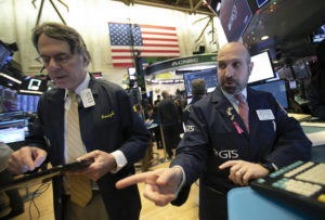 Stocks struggle higher as markets remain volatile; oil drops