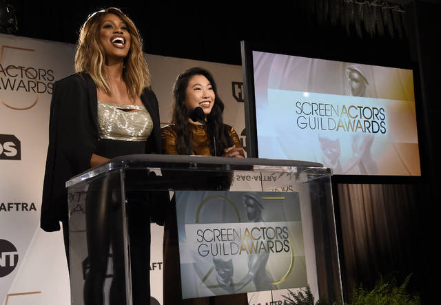 Presenters Laverne Cox, left, and Awkwafina announce nominations for the 25th annual Screen Actors Guild Awards at the Pacific Design Center on Wednesday, Dec. 12, 2018, in West Hollywood, Calif. The show will be held on Sunday, Jan. 27, 2019, in Los Angeles. (Photo by Chris Pizzello/Invision/AP)