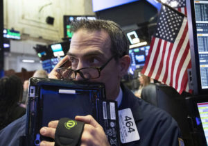 Wall Street ends higher with help from tech and health care