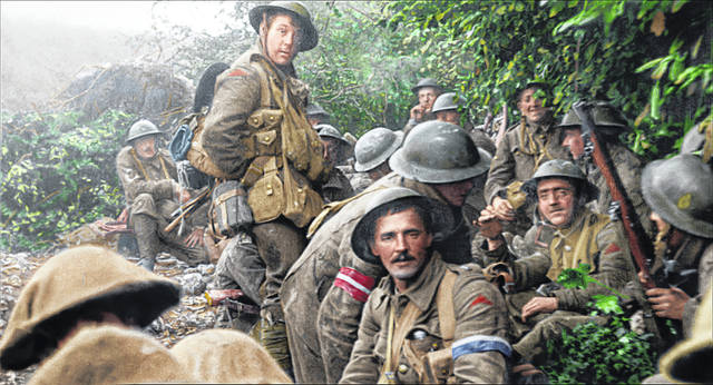 """This image released by Warner Bros. Entertainment shows a scene from the World War I documentary """"They Shall Not Grow Old,"""" directed by Peter Jackson. Jackson drew on all the technical know-how of his big-budget spectacles to turn hundreds of hours of footage from the Western Front and audio of surviving soldiers into a seamless, unobstructed portrait of the war as seen from the British trenches. Jackson altered frame rates, colorized and turned 3-D the footage, even employing lip readers to capture dialogue."""