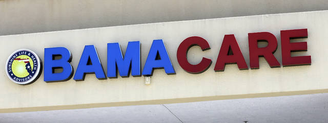 """File- This May 11, 2017, file photo shows an Obamacare sign being displayed on the storefront of an insurance agency in Hialeah, Fla. A conservative federal judge in Texas on Friday, Dec. 14, 2018, ruled the Affordable Care Act """"invalid"""" on the eve of the sign-up deadline for next year. But with appeals certain, even the Trump White House said the law will remain in place for now. In a 55-page opinion, U.S. District Judge Reed O'Connor ruled Friday that last year's tax cut bill knocked the constitutional foundation from under """"Obamacare"""" by eliminating a penalty for not having coverage. The rest of the law cannot be separated from that provision and is therefore invalid, he wrote. (AP Photo/Alan Diaz, File)"""