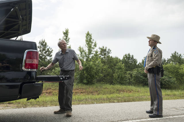 "This image released by Warner Bros. Pictures shows Clint Eastwood, left, in a scene from ""The Mule."" (Claire Folger/Warner Bros. Pictures via AP)"
