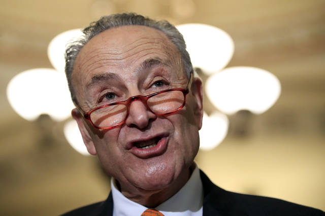 FILE - In this Dec. 11, 2018, file photo, Senate Minority Leader Chuck Schumer, D-N.Y., speaks to reporters on Capitol Hill in Washington. The White House on Sunday, Dec. 16, pushed the federal government closer to the brink of a partial shutdown later this week, digging in on its demand for $5 billion to build a border wall as congressional Democrats stood firm against it. Democratic congressional leaders, Schumer and Rep. Nancy Pelosi, have proposed no more than $1.6 billion, as outlined in a bipartisan Senate bill. The money would not go for the wall but for fencing upgrades and other border security. (AP Photo/Manuel Balce Ceneta, File)