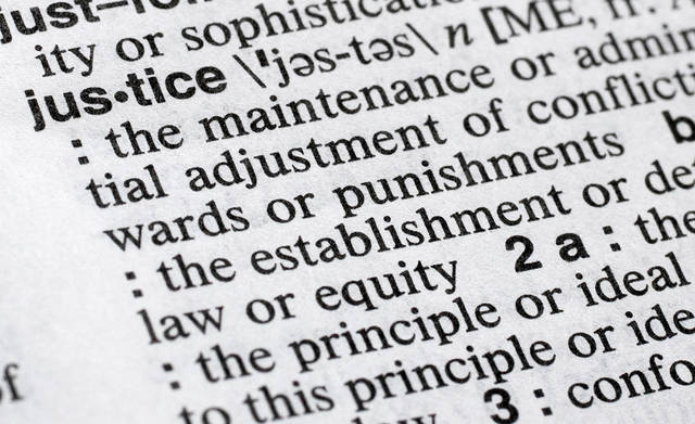 """""""Justice"""" is displayed in a Merriam-Webster dictionary in New York. Merriam-Webster has chosen """"justice"""" as its 2018 word of the year, driven by the churning news cycle and President Trump's Twitter feed."""