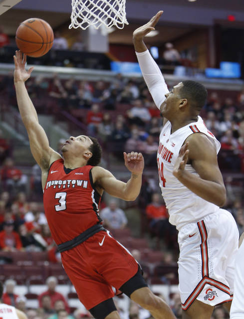 Youngstown State's Darius Quisenberry, left, shoots over Ohio State's Kaleb Wesson during the first half of an NCAA college basketball game Tuesday.