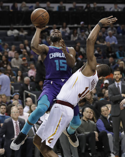 Charlotte Hornets' Kemba Walker (15) drives against Cleveland Cavaliers' Alec Burks (10) during the second half of an NBA basketball game in Charlotte, N.C., Wednesday, Dec. 19, 2018. (AP Photo/Chuck Burton)