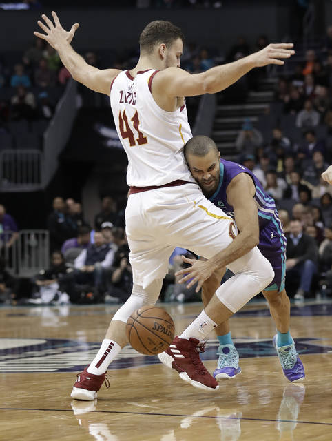 Charlotte Hornets' Tony Parker, right, drives around Cleveland Cavaliers' Ante Zizic (41) during the second half of an NBA basketball game in Charlotte, N.C., Wednesday, Dec. 19, 2018. (AP Photo/Chuck Burton)