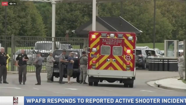 "In this Aug. 2, 2018, file photo, taken from video provided by WKEF, authorities work at the Wright-Patterson Air Force base in Ohio amid reports of an active shooter at the base. The Ohio Air Force base  plans to release its findings on Wednesday, Dec. 19, 2018, into a chaotic ""active shooter"" false alarm after a 911 call to base security. (WKEF via AP)"