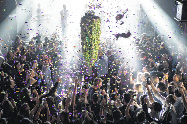 A depiction of a cannabis bud drops from the ceiling at Leafly's countdown party in Toronto as midnight Oct. 17 passes and marks the first day of the legalization of cannabis across Canada. The last year was a 12-month champagne toast for the legal marijuana industry as the global market exploded and cannabis pushed its way further into the financial and cultural mainstream.
