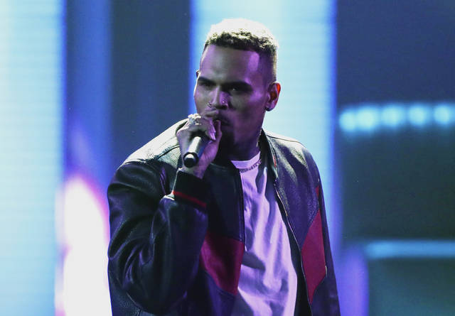 "FILE - In this June 25, 2017, file photo, Chris Brown performs at the BET Awards at the Microsoft Theater in Los Angeles. Brown released a 45-song album ""Heartbreak on a Full Moon"" on Tuesday, Oct. 31. Brown has been charged with monkey-related misdemeanors. The Los Angeles city attorney's office confirms Thursday, Dec. 27, 2018, that the 29-year-old singer was charged last week with two counts stemming from his possession of a pet capuchin monkey without a permit. (Photo by Matt Sayles/Invision/AP, File)"