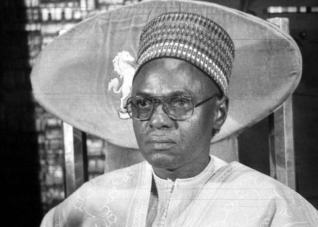 "FILE - In this B/W file photo dated circa 1983, showing President of Nigeria Shehu Shagari, at a press conference in Lagos. The 93-year old Shehu Shagari, Nigeria's second president whose civilian tenure was sandwiched between military rulers, has died and Nigeria's current President Muhammadu Buhari, said on Saturday that he mourns ""the departure of a patriot."""