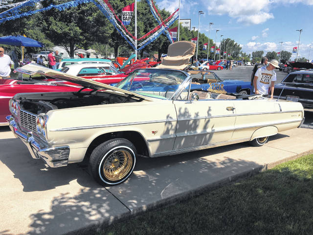 "Pat Law, of Lima, likes the ""classic Chevy style"" of his 1964 Chevy Impala convertible."