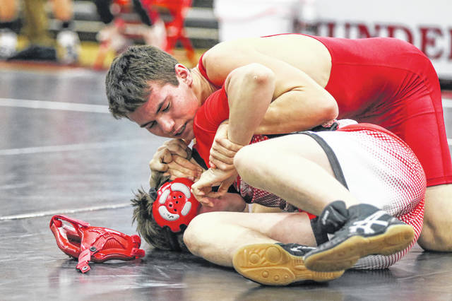 Delphos Jefferson's Nate Brown wrestles during a bout against Bluffton's Elijah Conley at Saturday's Allen County Tournament at Lima Central Catholic.