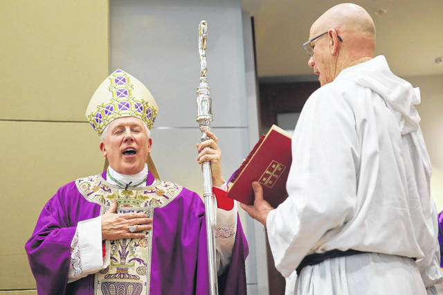 Bishop Daniel Thomas leads a centennial service at Mercy Health St. Rita's Medical center Tuesday.
