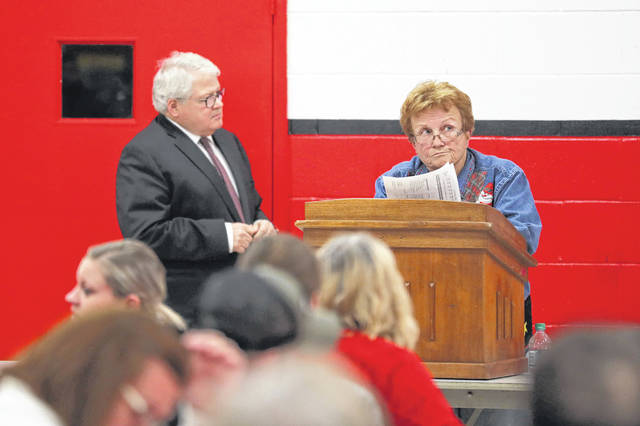 Catherine Heitz, of Landeck, reacts during the board meeting held at Delphos Jefferson High School on Thursday.