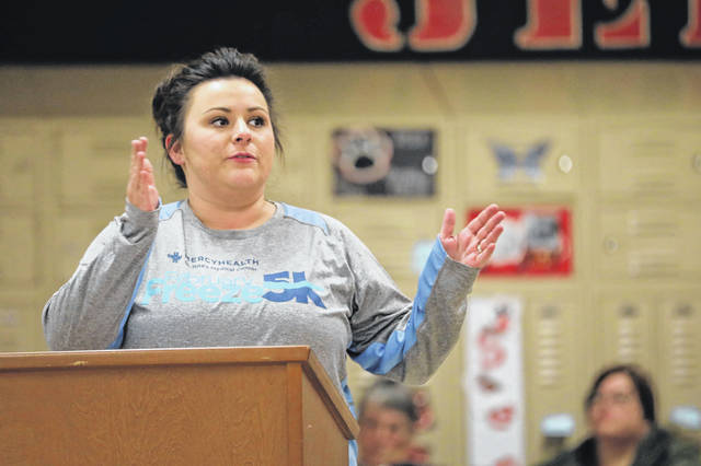 Mother of four Lindsay Richards pleads with the board to understand how she feels about the closing of Landeck schools during the board meeting held at Delphos Jefferson High School on Thursday.