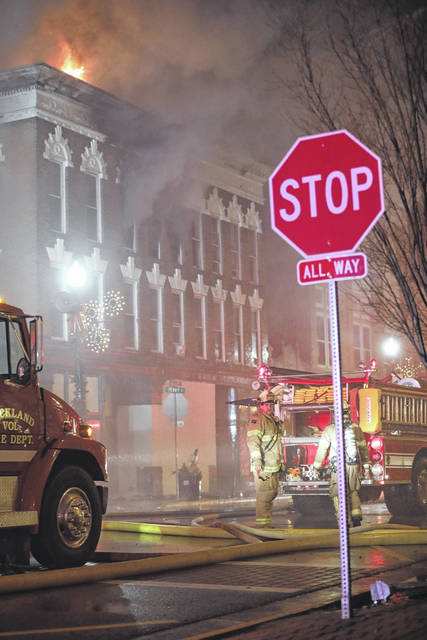 Firemen remained on the scene of a downtown Wapakoneta fire until approximately 8 a.m. Monday before the blaze was fully extinguished.