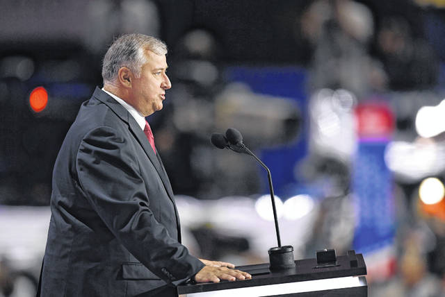 FILE - In this July 18, 2016 file photo, former Speaker of the Ohio House Larry Householder speaks during the opening day of the Republican National Convention in Cleveland. The state watchdog is alleging widespread fraud within the Ohio agency that provides prison jobs for inmates, including furniture building and vehicle repair. A report released Thursday, Dec. 20, 2018, by Inspector General Randall Meyer accuses top employees of Ohio Penal Industries of using their positions for personal gain, such as discounts on personal car repairs by inmates. The IG report says Householder was provided an office table and chair set at no cost.